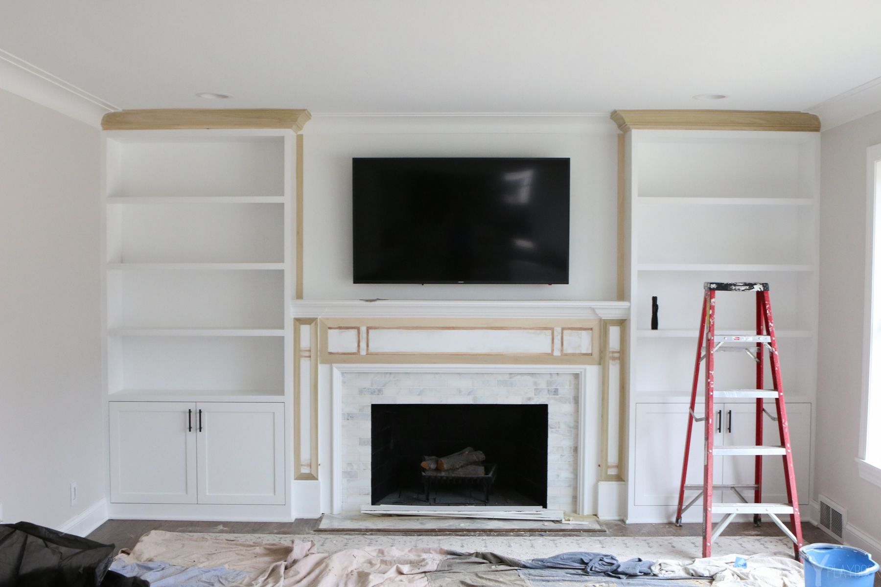 White Built Ins Around The Fireplace Before And After inside dimensions 1800 X 1200